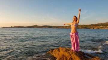 Spiritual woman pointing upward for guidance